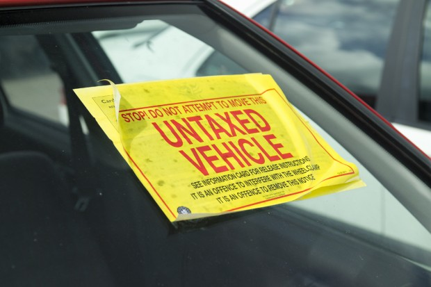 car winscreen with an untaxed vehicle sticker attached