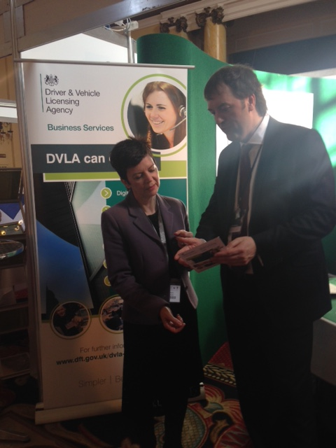 Jonathan Humble, Head of DVLA's new Business Development team talking to a lady visitor to DVLA's stand at the Procurex Wales Live event