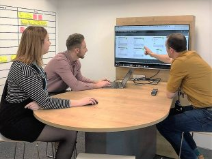 3 DVLA staff in meeting looking at a screen