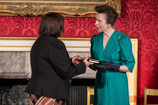 Deborah Nicholas being presented with a Princess Training award by Princess Anne